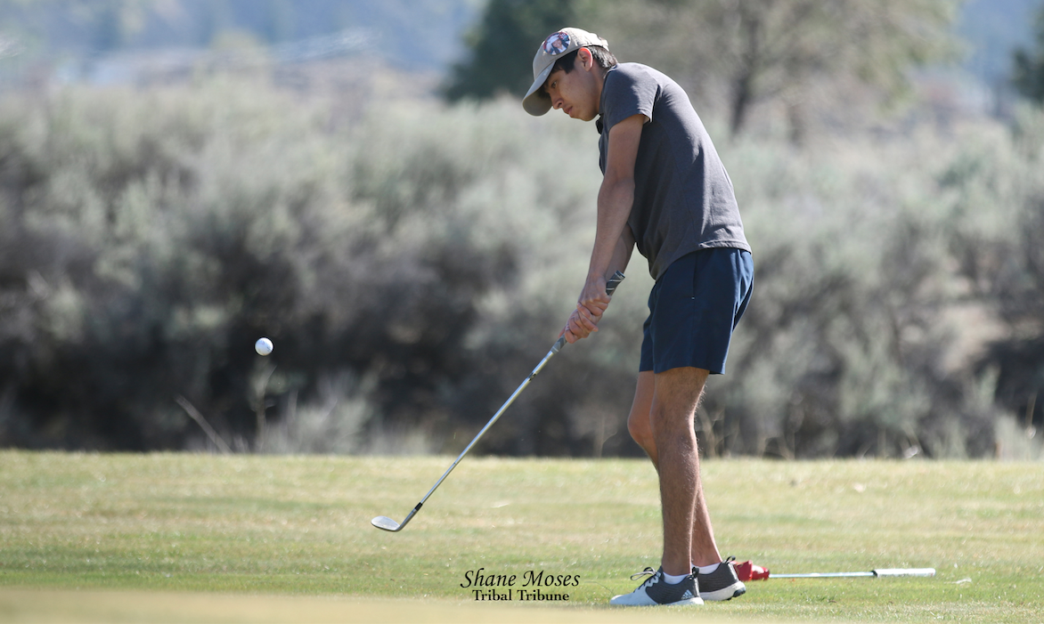 Colville tribal descendant Daxton Whiteman of Lake Roosevelt chips a shot on the 8th hole in a home match Monday (April 19) afternoon at Banks Lake Golf Course