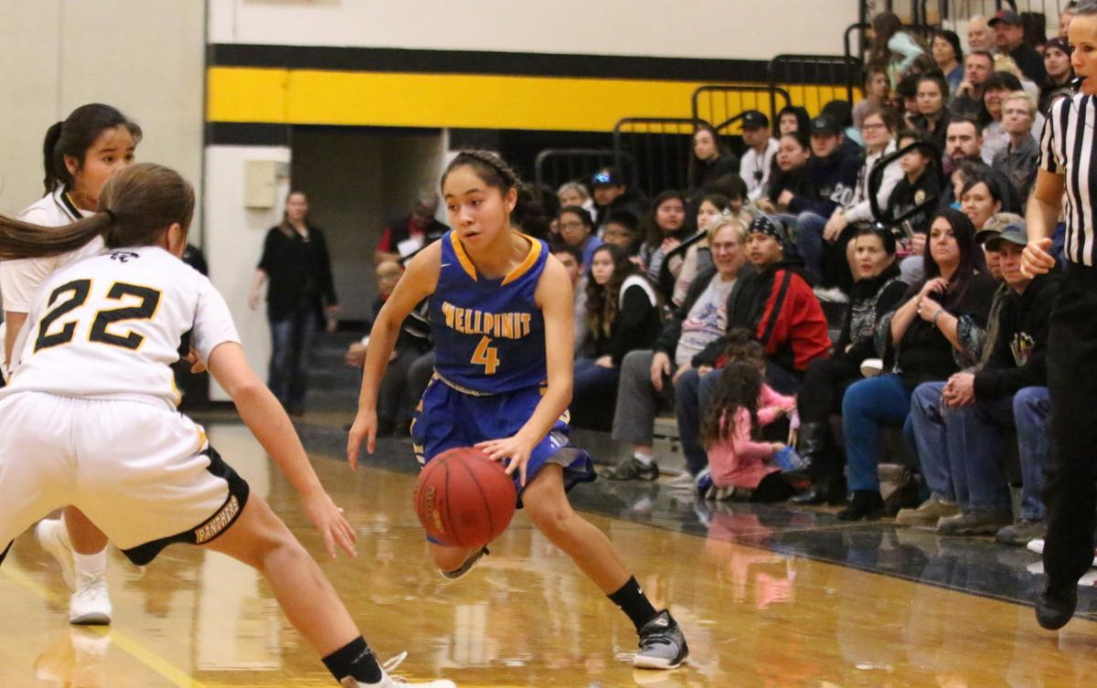 Colville tribal member Ashlynn Hill (No. 4 blue) of Wellpinit dribbles the ball up court against Cusick on Friday evening in Northeast 1B non-division play.