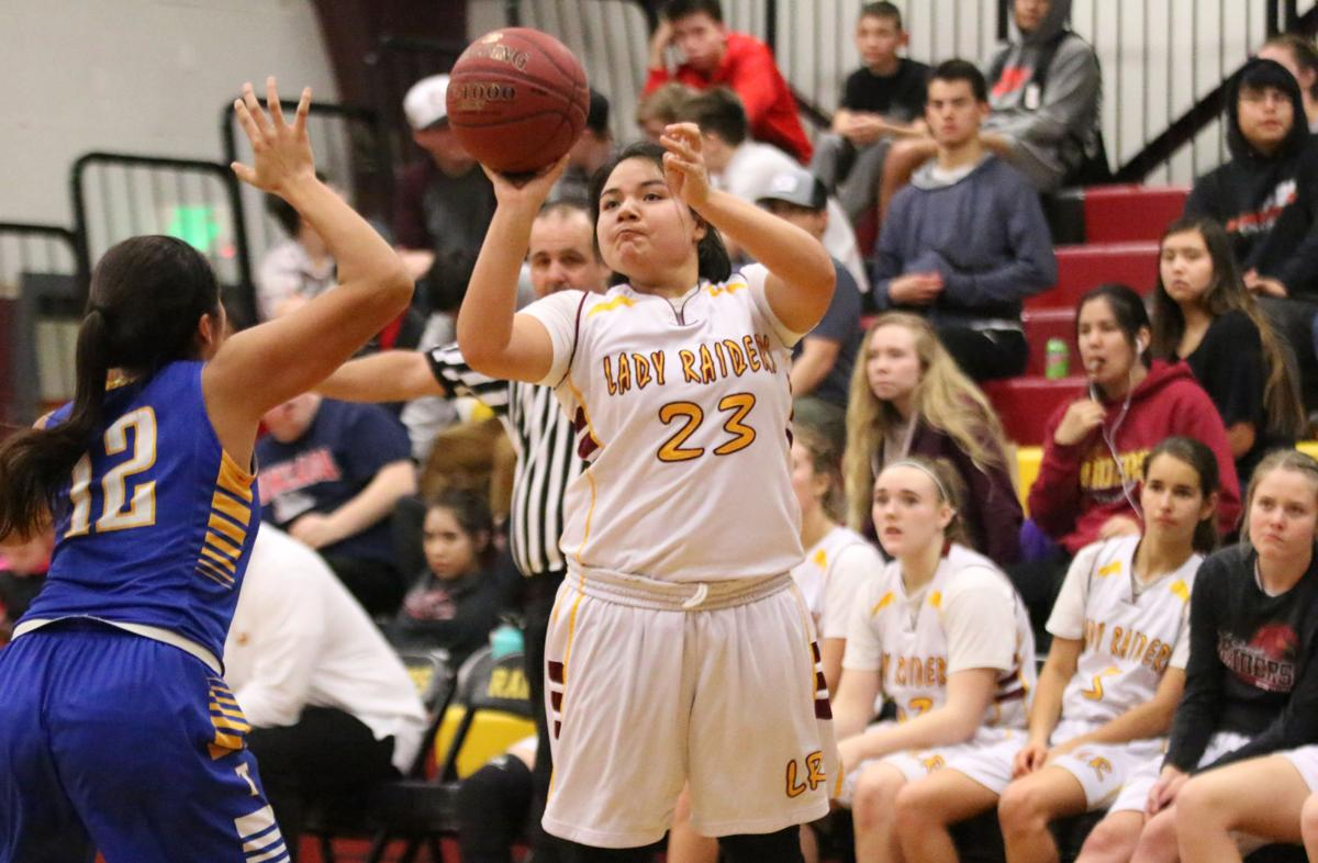 Colville tribal member Khani Priest of Lake Roosevelt shoots from 3-point land against Tonasket on Wednesday evening in Central Washington 2B League play