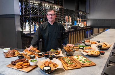 Executive Chef Petapuka Devereaux showcases items from the new menu at the Loggers Pub.
