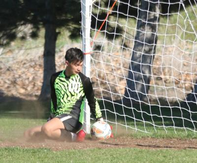 Tribal member Tyler Sam goalie for Omak makes a save against Okanogan in the first half on Tuesday (April 23) evening. Okanogan won 1-0 late in the game