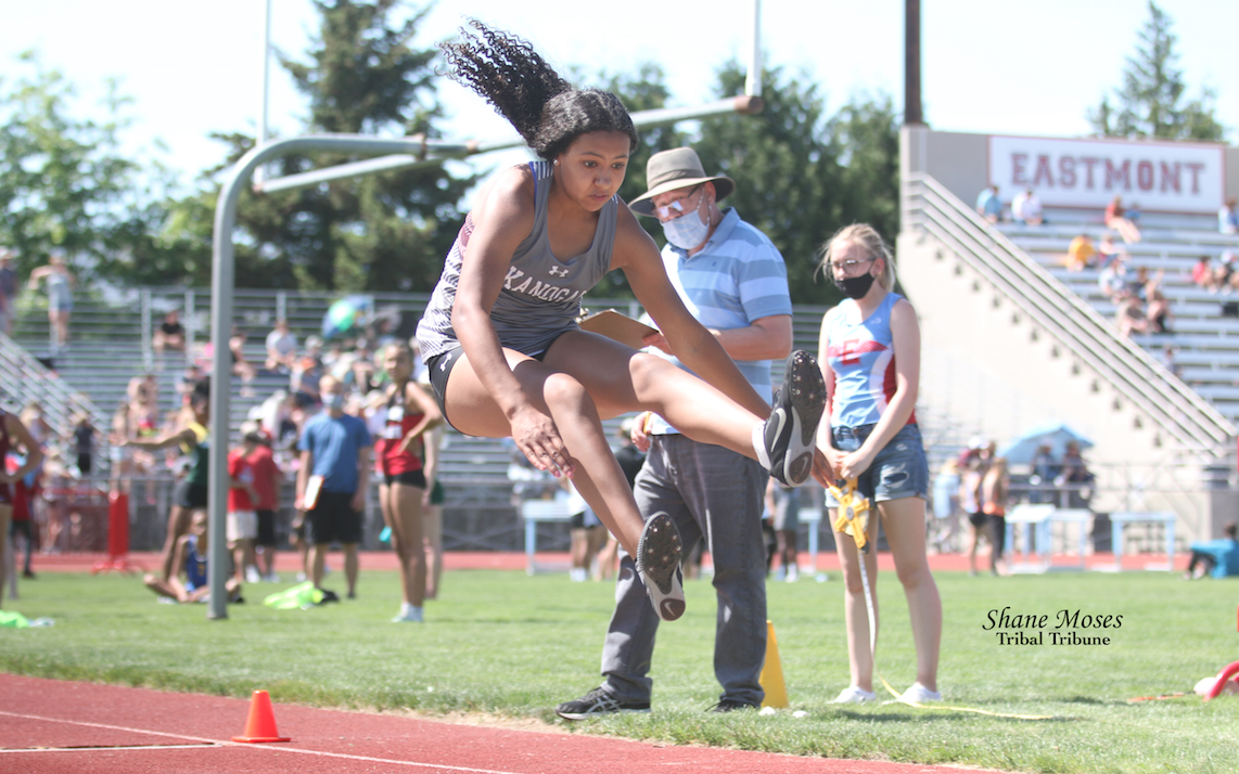 Colville tribal member Sydney Sparks of Okanogan competes in the final round of the long jump at the NCW Region Championships at Easmont High School (May 15) in Wenatchee. Sparks would go on to place third in the long jump that day with a best jump of (15' 1.5)