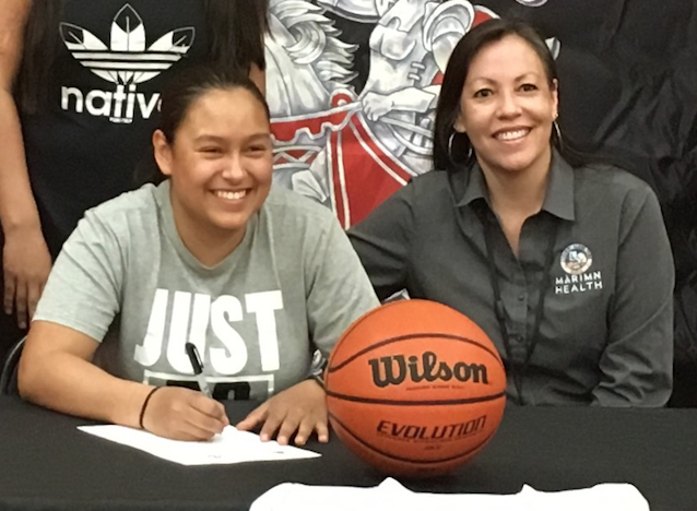 Tommia Pakootas signing her letter of intent