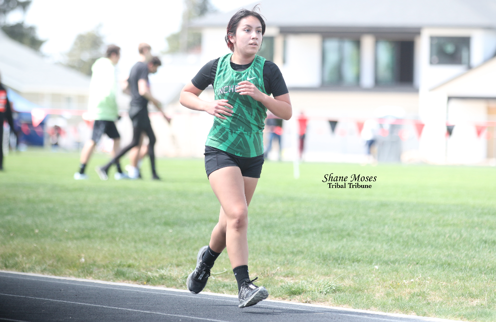 Colville tribal member Clarissa Stensgar of Inchelium runs in the 3200-meter championship race at the District 7 and 9 Track and Field Championships on May 7 at Ritzville High School. Stensgar placed fifth