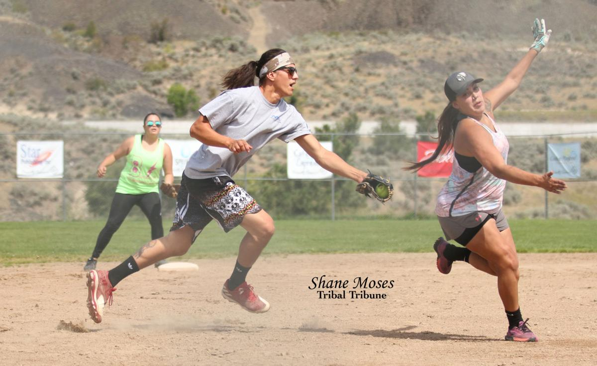 Ed Wolfe (Colville Tribal member) of Team Bowman attempts to tag out Leah Dick (Colville Tribal member) of Team Inchelium on Saturday afternoon. The winner would advance to the championship game for the Grand Coulee Area Co-Ed Softball League Tournament held at North Dam Park in Grand Coulee