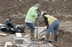 Colville tribal member Curtis Abrahamson works on the foundation of a dormitory building at the Colville Tribal Substance Abuse Treatment Center, Feb. 15.