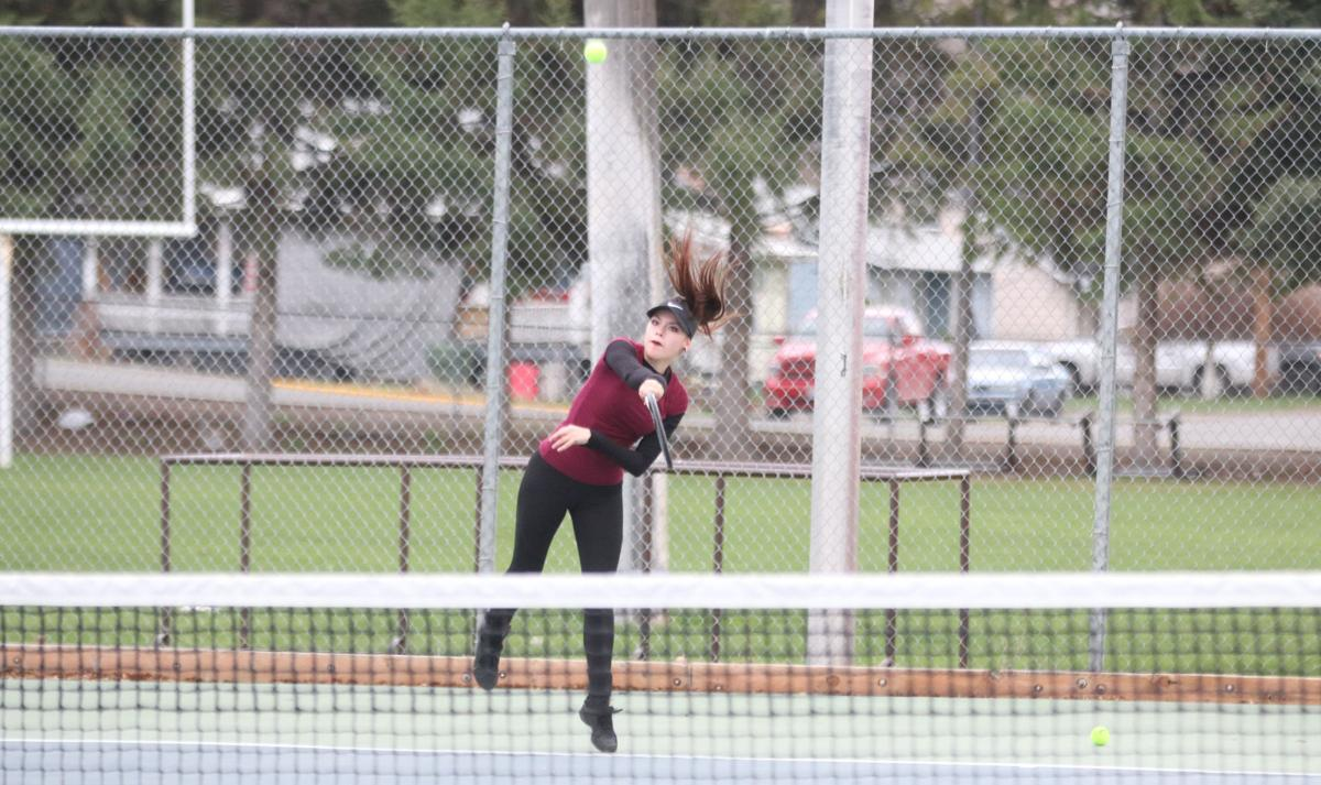 Colville tribal member Tarissa Clark of Lake Roosevelt serves against the Pioneers in non-league play on Friday (April 12) evening in doubles action at Omak High School