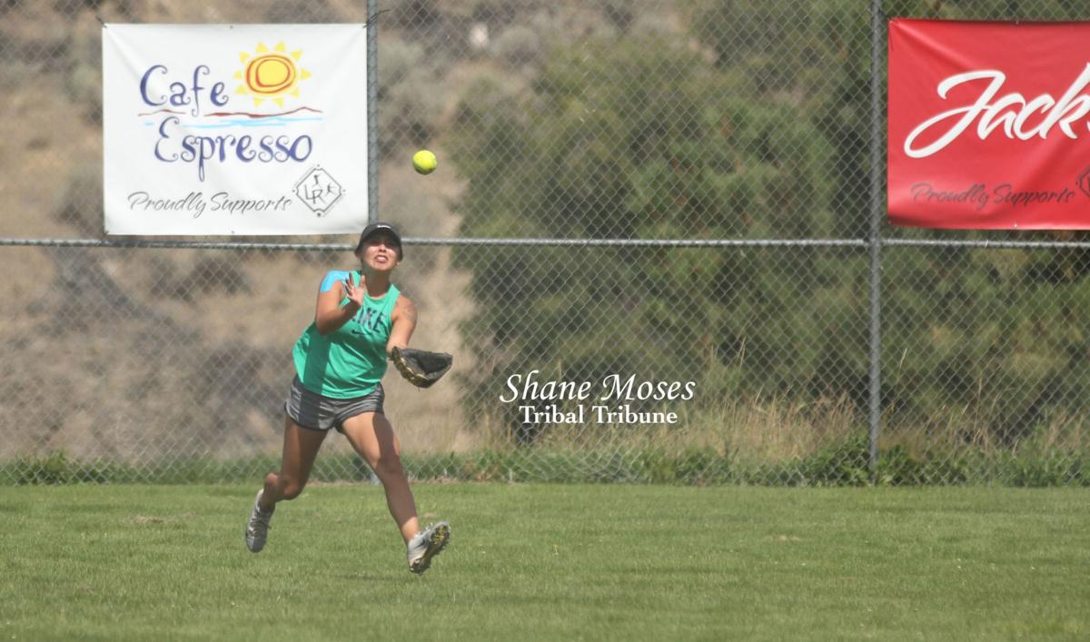 Kori Jackson (Colville Tribal member) of Team Inchelium catches a fly ball on Saturday afternoon in the GCD Co-Ed Softball League Tournament