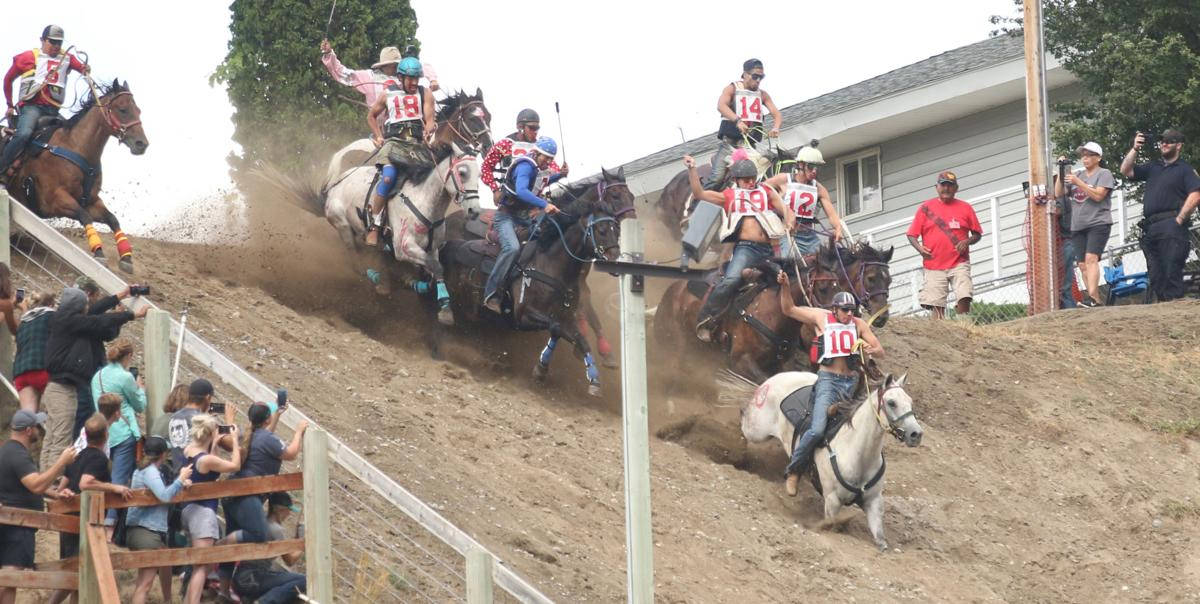 Oliver Pakootas (#10) and Onyx (grey horse) lead the way down the hill as the rest of the field follows on Sunday afternoon