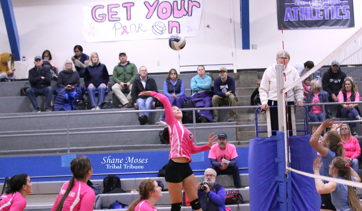 Colville tribal member Mackenzie Arden (#2 pink) of Wilbur-Creston goes up for a spike against Chewelah on Oct. 22 in Northeast 2B North League action