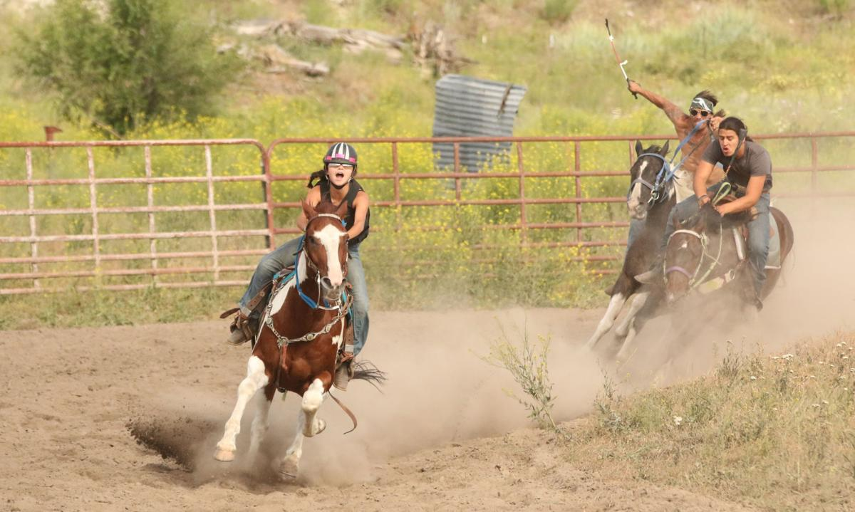 Colville tribal youngster Talliyah Timentwa riding on Bear, would go on to hold off fellow tribal members Tarren and Jason Meusy in the half-mile paint race on Saturday afternoon (June 23) at the Pakootas Dam Horse Races in Nespelem
