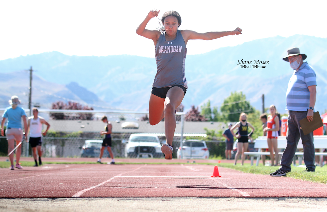 Colville tribal member Danielle Sparks of Okanogan competes in the final round of the triple jump at the NCW Region Championships at Easmont High School (May 15) in Wenatchee. Sparks went on to place first in the triple jump that day with a best jump of (33' 9)