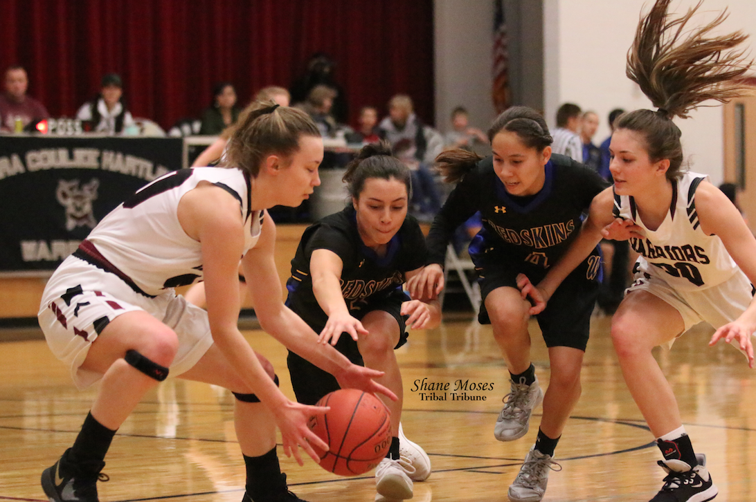 Jada Orr (#3 black) and teammate Colville member Ashlynn Hill (#4 black) of Wellpinit pressure Makenna Oliver (#40 white) of Almira/Coulee-Hartline on Feb. 1 in NE 1B South League action. Wellpinit won 58-50.