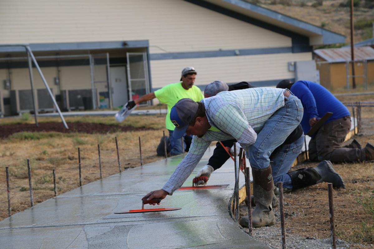 Doc Walker, Jesse Palmer Construction, works concrete in creating a bike path at Nespelem Head Start in August.