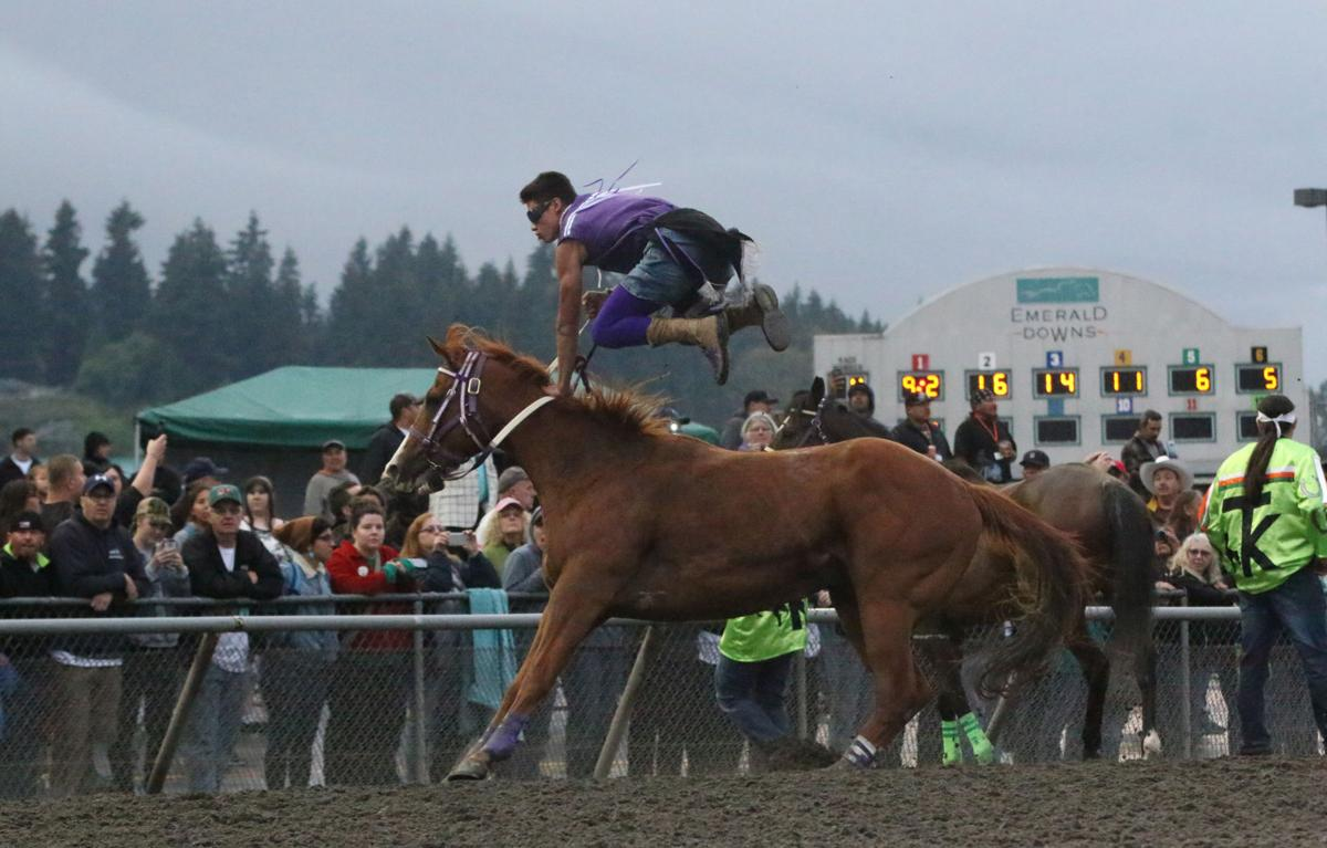 Colville tribal member Scott Abrahamson leaps off his horse and gets ready to hop on another, Friday night (June 8) at the third annual Muckleshoot Gold Cup at Emerald Downs racetrack in Auburn