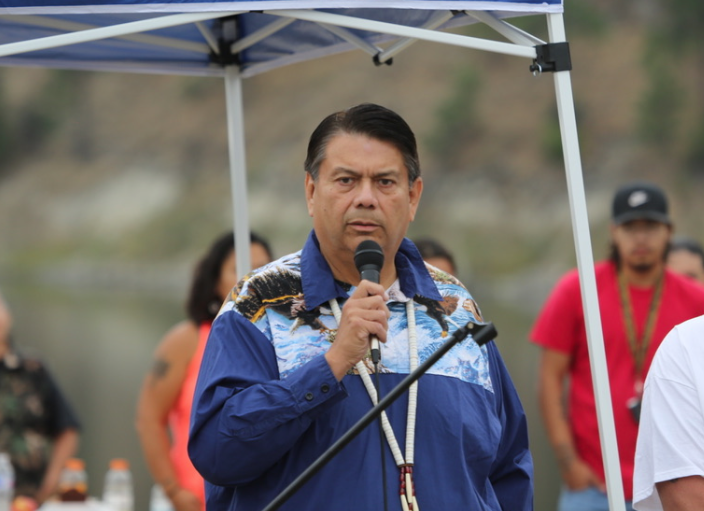 Colville Business Council chair Rodney Cawston speaks before the cultural release of salmon into Rufus Woods, Friday.