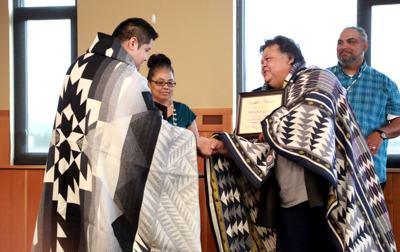 Colville tribal members Daniel Nanamkin and Willie Coleman celebrated their graduation from the Colville Tribal Healing to Wellness Court, May 17 in Nespelem.
