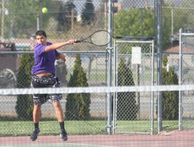 Aiden Hall of Pateros smashes a forehand against the Hornets in a league match on Monday April 29 at Oroville High School
