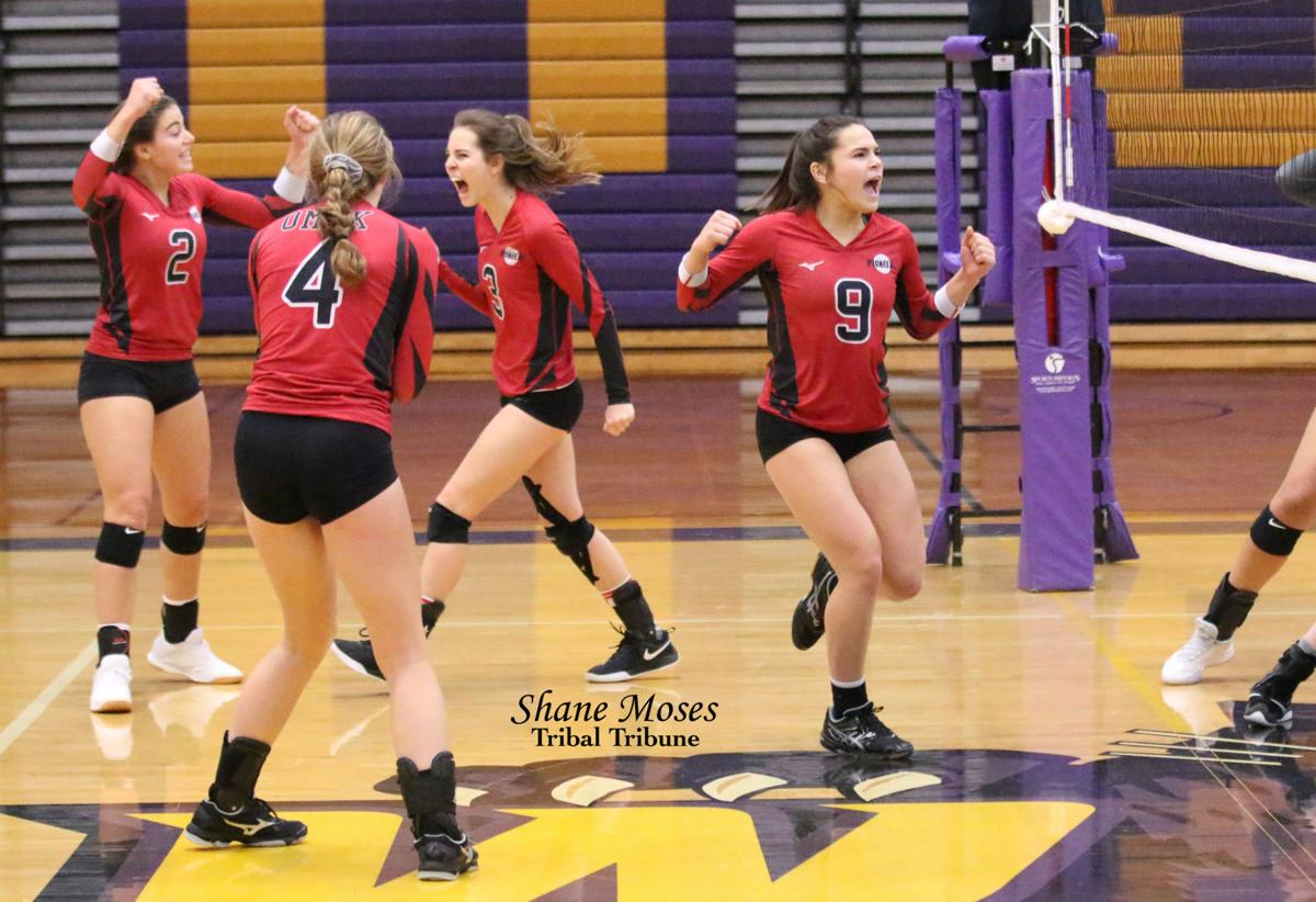 Colville tribal member Trinity Fjellman of Omak celebrates with her teammates after the Pioneers beat Cascade 3-1 in the Caribou Trail League District Volleyball Tournament, Nov. 9 in Wenatchee