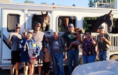 Colville tribal members, Tyler Peasley, Jimmy Marchand, Virgil Tonasket and John Pakootas stand with family and friends after winning in Sheridan, July 17