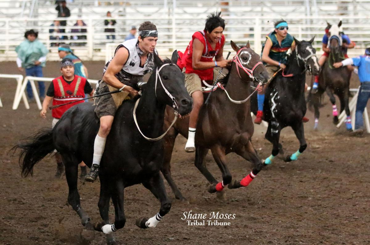 Riley Prescott (white) jockey for Omak Express gets off to a fast start in the Consolation Championship Race on Sunday afternoon at the Walla Walla County Fair Grounds