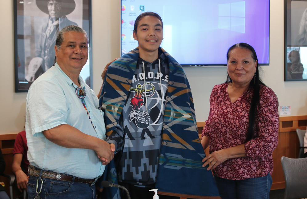 Colville Confederated Tribes Business Council Andy Joseph Jr. and Karen Condon shakes hands with Alonzo Adams on Monday (Aug. 2) afternoon in Council Chambers as the CBC honored Adams with a Pendleton blanket