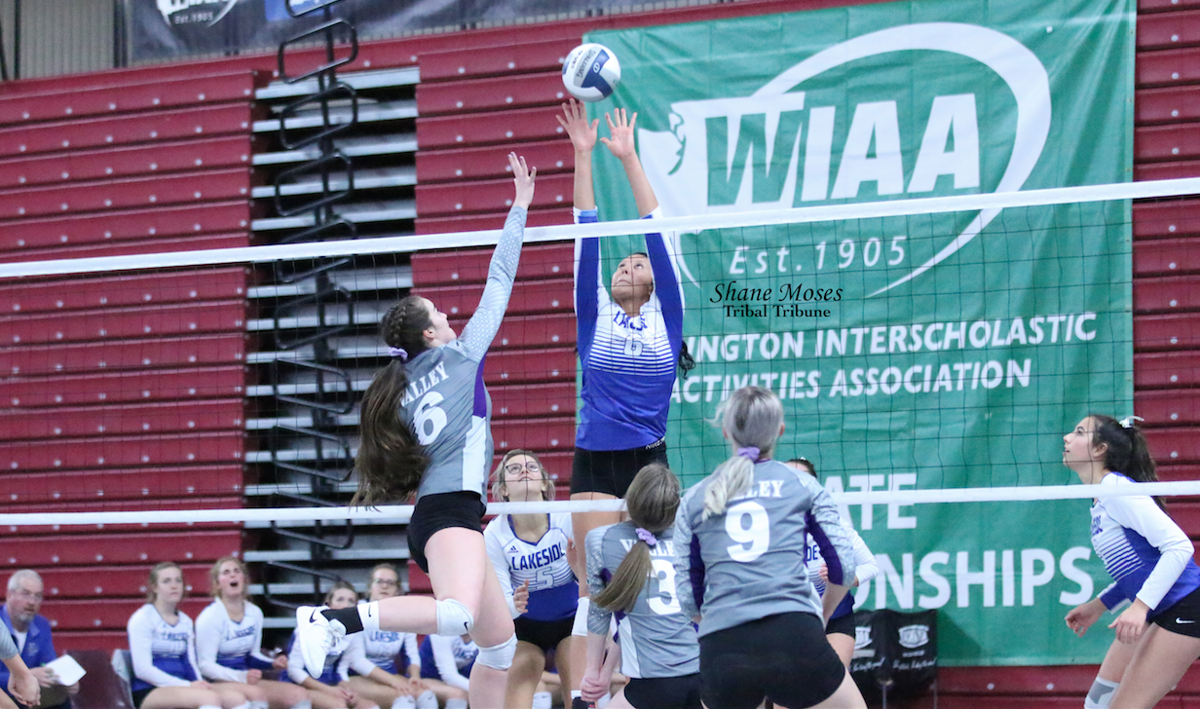 Colville tribal member Mia Pakootas of Lakeside blocks a shot against Nooksack Valley in the WIAA 1A State Volleyball Tournament at the Yakima Valley SunDome on Friday (Nov. 15) evening.