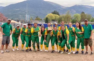 The Inchelium softball team is all smiles after they knocked off Almira/Coulee-Hartline (2-1) for the District 5/6/7 title at Kettle Falls High School on Saturday