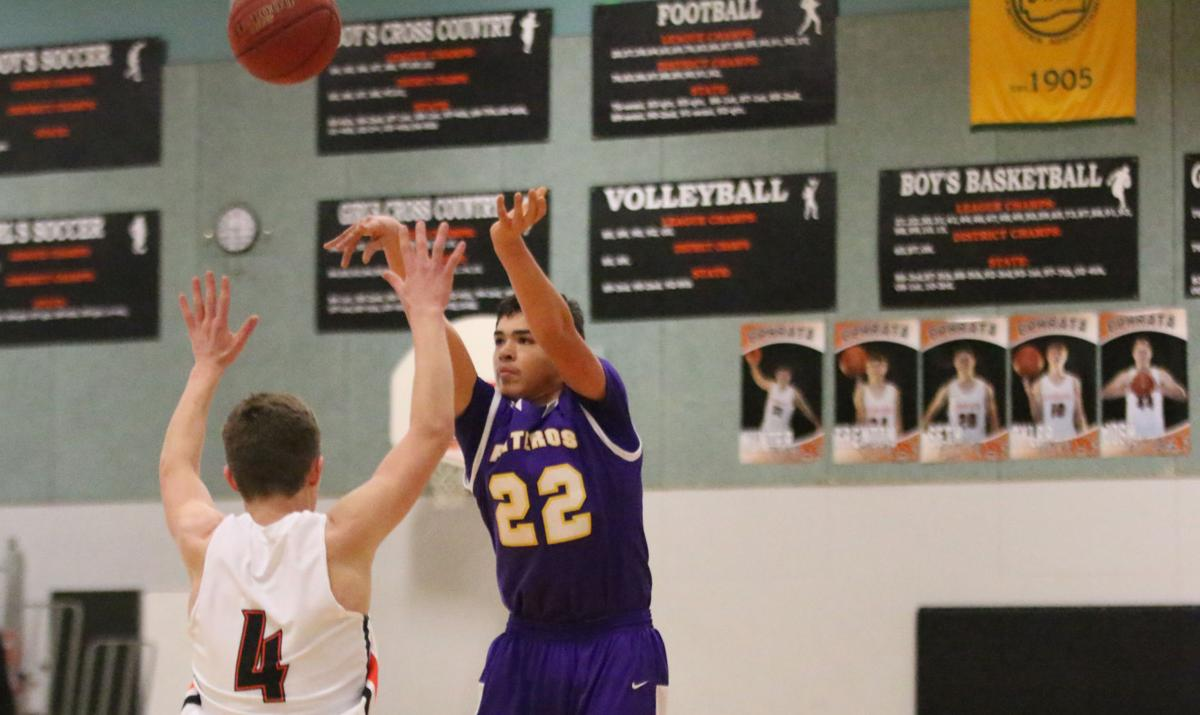 Aiden Hall (#22 purple) of Pateros steps back and takes a 3-point shot against Entiat on Friday evening in the CWA 1B District 6 Tournament at Ephrata High School