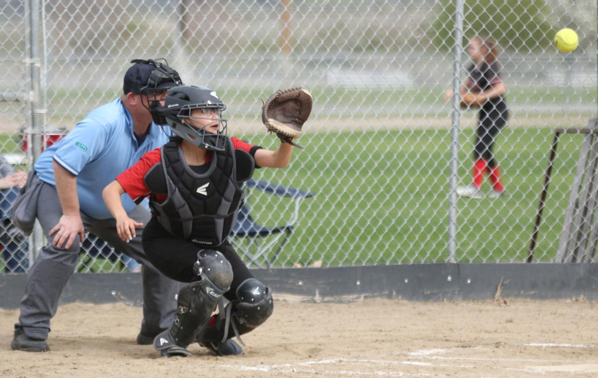 Tribal member Taylor Palmanteer, catcher for Omak gets ready to catch a pitch from Sidney Nichols on Friday (April 19) afternoon