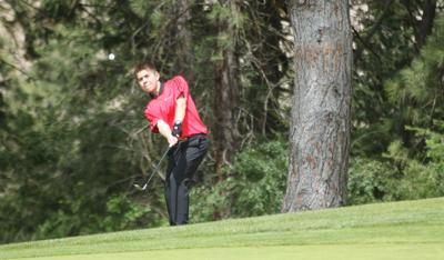 Colville tribal member Camden Mills chips a shot at the 4A boys state golf tournament on May 21