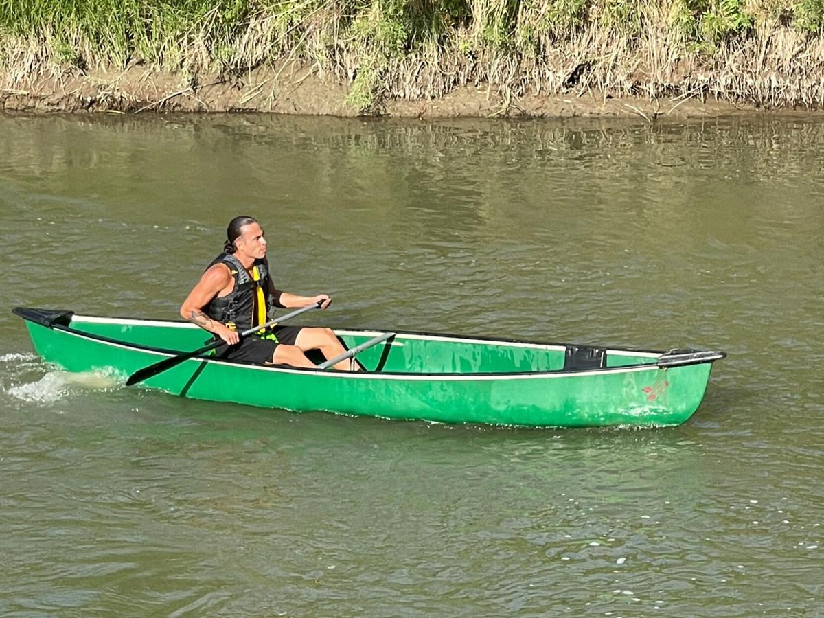 Colville tribal member Tony Louie competes in this year's Ultimate Warrior Challenge (June 27) out on the Crow Nation in Montana this past summer as he tackles the Canoe portion of the race
