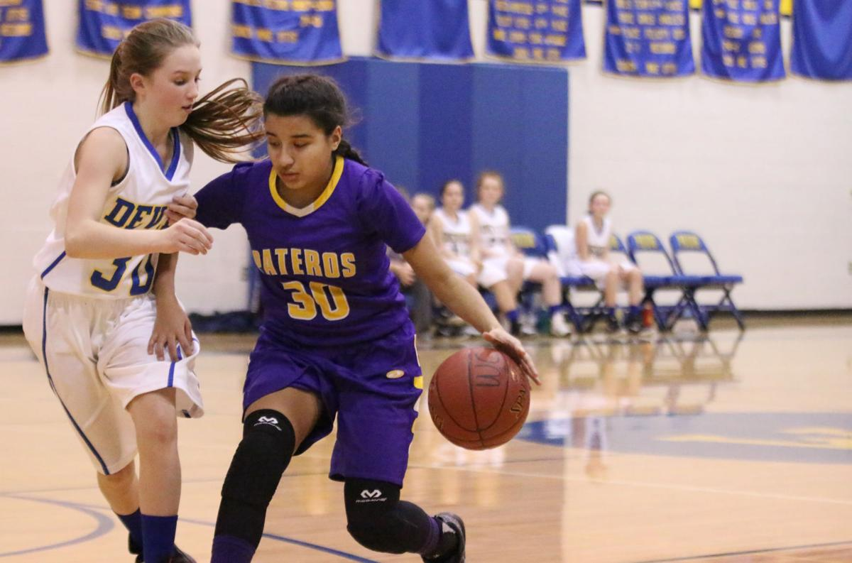 Colville tribal member Aleeka Smith of Pateros drives to the hoop against Wilson Creek's Anissa Odorizzi on Friday evening in CWB 1B action.