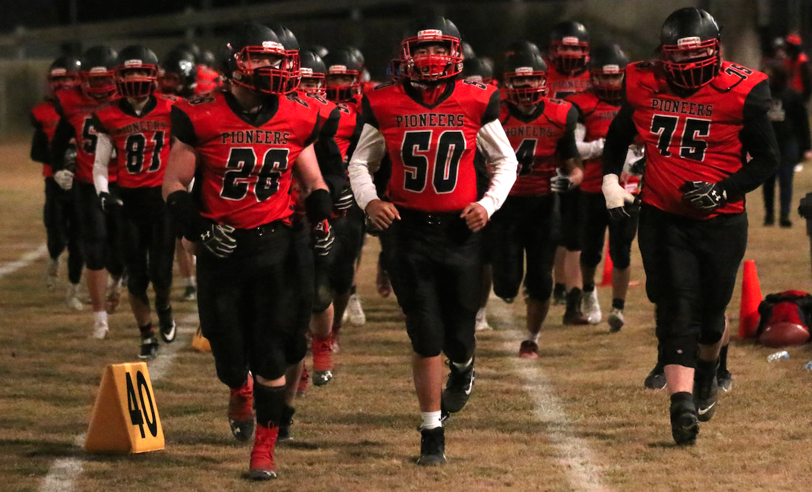 The Omak Pioneers football team makes their way to the field for the second half against Chelan in Caribou Trail League action on March 12. Chelan would go on to win 29-6.