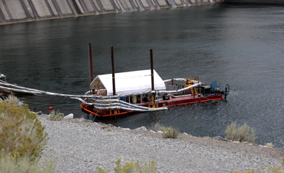 The Whooshh Innovations System Passage Portal, a barge installed temporarily below Chief Joseph Dam near Bridgeport, demonstrates fish passage possibilities over the high-head dam.