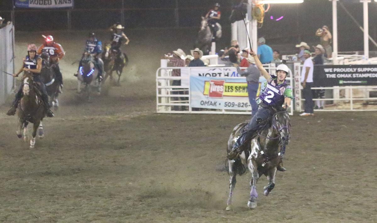Riley Prescott holds his hand in the air, having just won his second race in row on Saturday night at the World Famous Suicide Race
