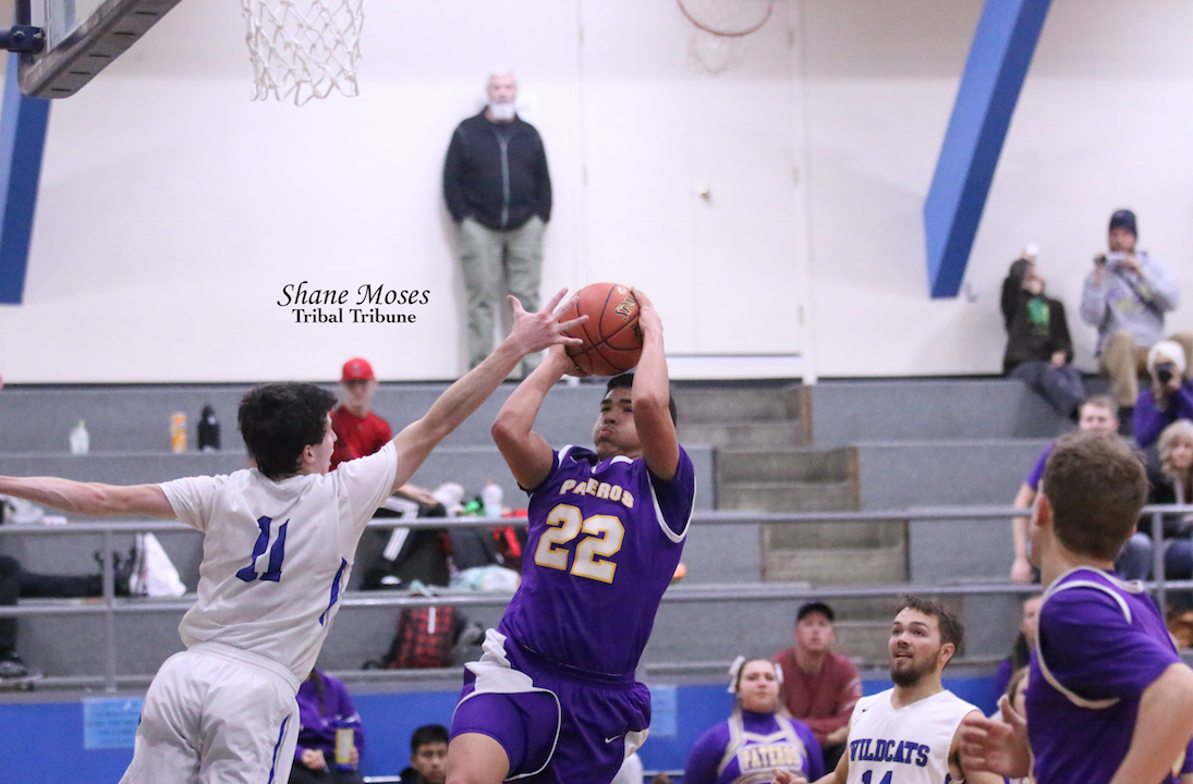 Colville tribal member Aiden Hall (#22 purple) of Pateros goes up for a shot against Wilbur-Creston on Dec. 13 in non-league action
