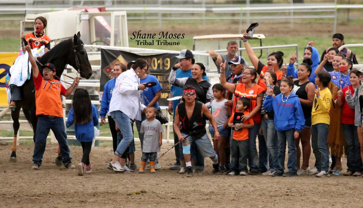 At far left, Talliyah Timentwa, on top of the horse Cheers, along with her dad Rocky Timentwa (holding the horse) and her family as she won the Ladies Relay Championship race on Sunday afternoon at the Walla Walla County Fairgrounds. Timentwa, only 13-years-old, is the first ever winner of the Ladies Relay race
