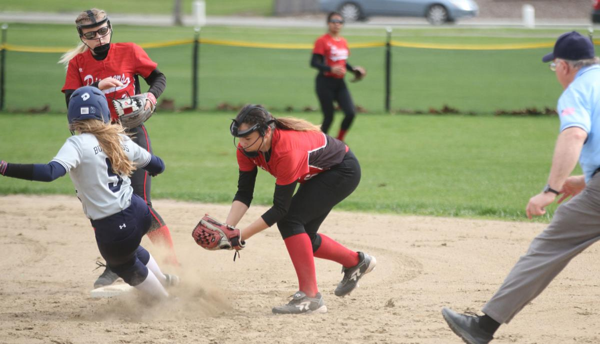 Tribal member Trinity Fjellman of Omak fields a ground ball and attempts to tag out a Kettle Falls base runner on Friday (April 19) afternoon