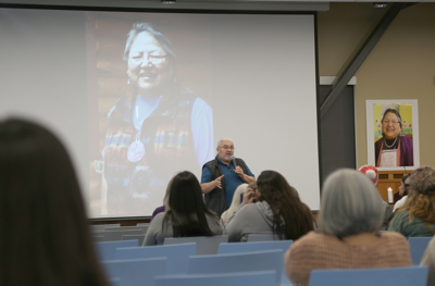 Colville Tribal Executive Director Francis Somday talks with employees gathered at a remembrance for tribal elder Gloria Atkins, Dec. 3 at the Lucy F. Covington Government Center in Nespelem. Atkins worked for the tribal education program for more than 45 years.