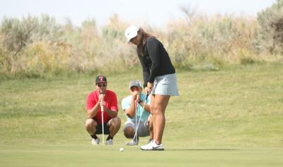 Tribal member Rachel Arthur gets ready to putt on Saturday afternoon at the 11th annual Rattler Open at Banks Lake Golf Course