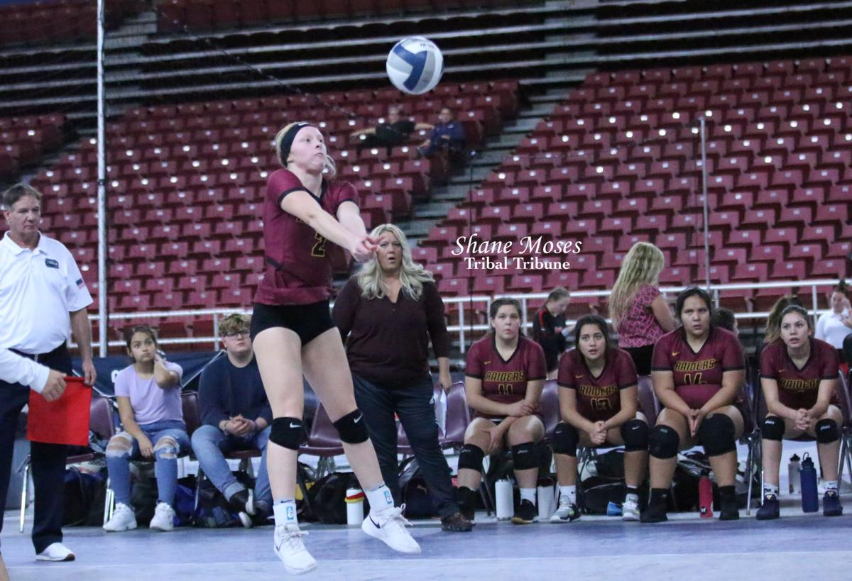 Colville tribal descendant Emma Marchand of Lake Roosevelt digs the ball against Chewelah in the WIAA 2B State Volleyball Tournament at the Yakima Valley SunDome on Thursday (Nov. 14) evening
