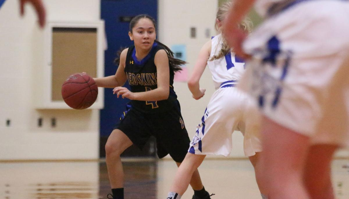 Ashlynn Hill (Colville tribal member) of Wellpinit (#4 black) drives to the hoop against Curlew on Tuesday evening in the first round of the District 7 1B Playoffs. Wellpinit won 70-57 at Curlew.