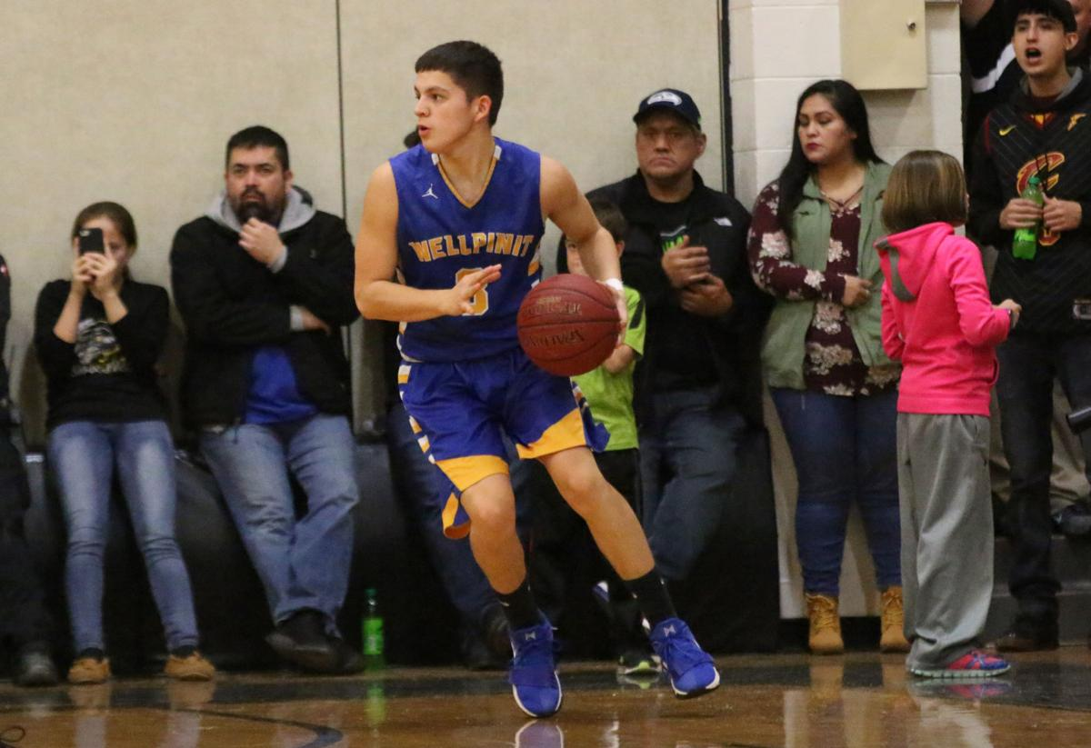 Colville tribal member Jake Flett of Wellpinit gets ready to shoot from 3-point land against Cusick on Friday evening in Northeast 1B non-division play.