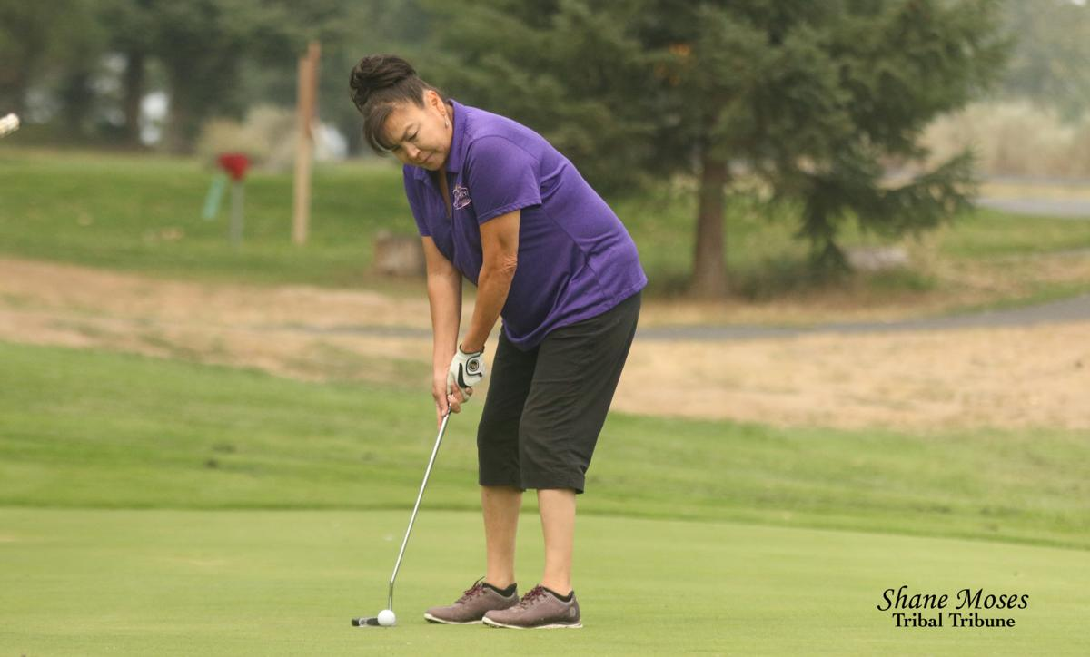 Colville tribal member Deb Condon putts a shot on the ninth hole at this year's 10th annual Rattler Open golf tournament from Banks Lake Golf Course on Saturday (August 25)