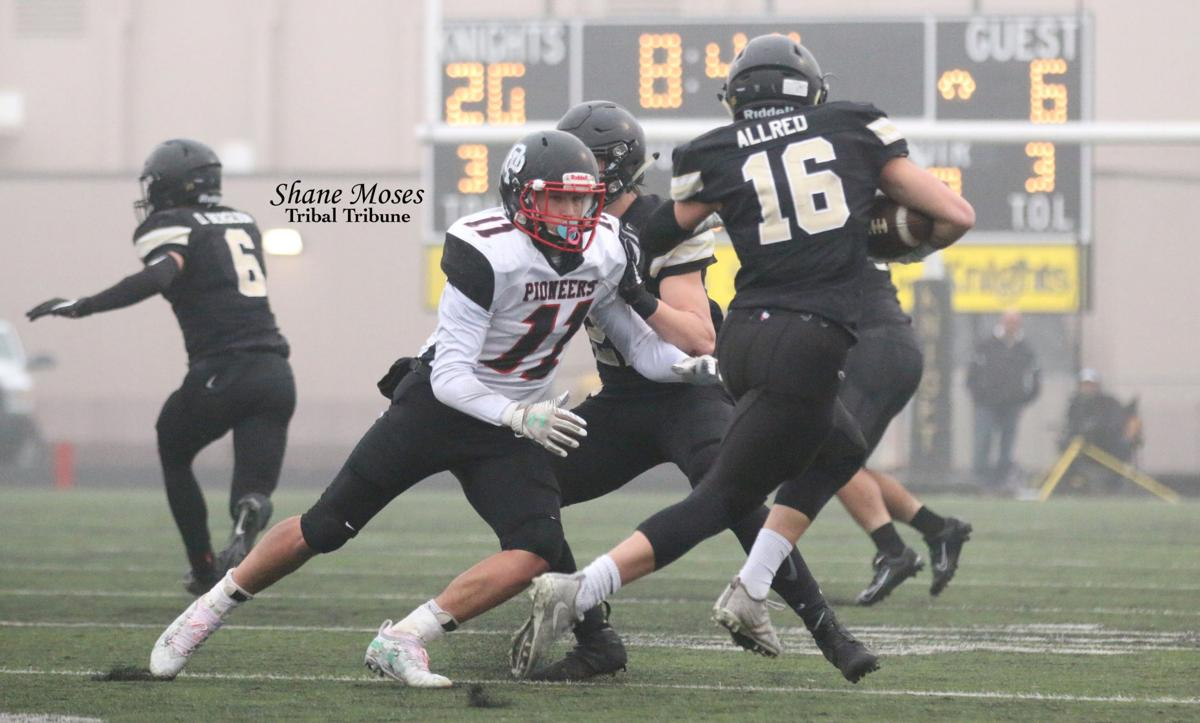 Colville tribal member Tanner Hall (#11 white) of Omak makes a tackle against Royal's Allred on Saturday (Nov. 23) afternoon in the quarterfinals of the WIAA 1A state playoffs