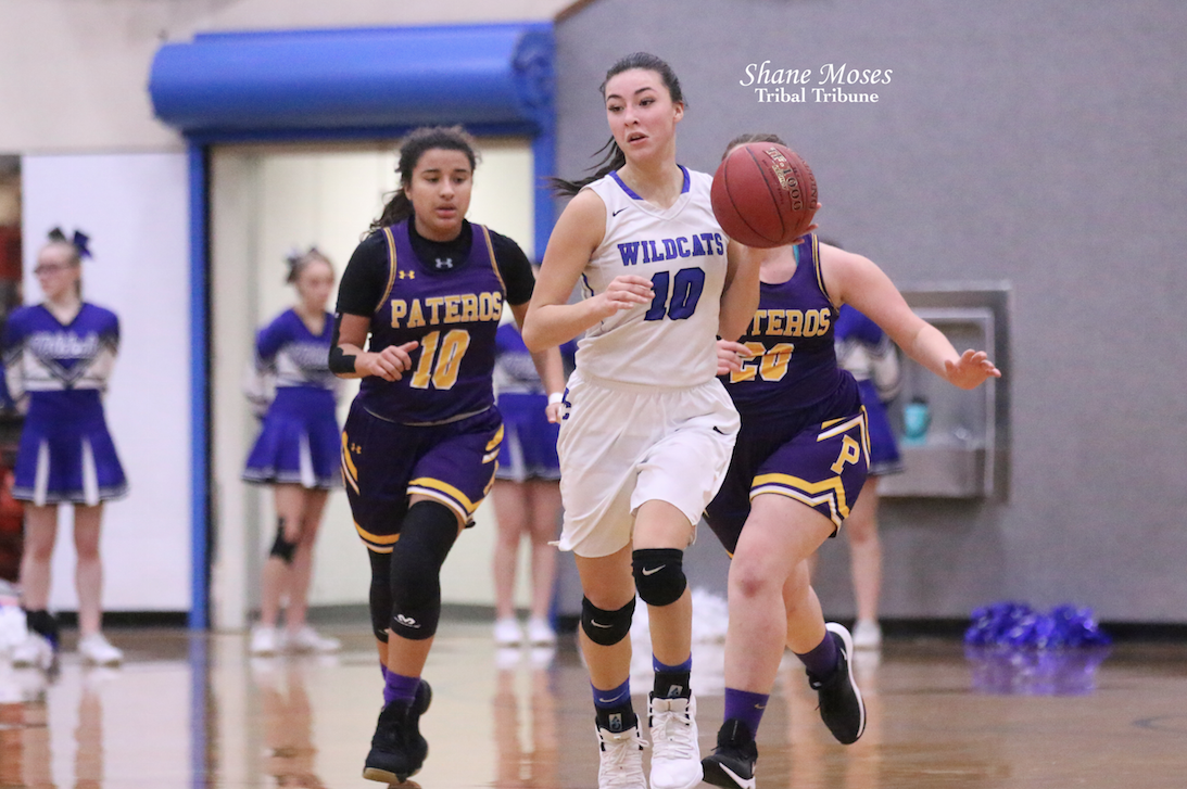 Colville tribal member Mackenzie Arden (#10 white) of Wilbur-Creston dribbles the ball up court against Pateros on Dec. 13 in non-league action