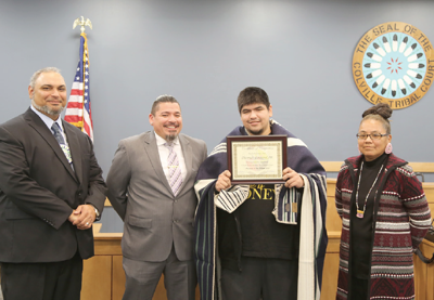 Colville Tribal Healing to Wellness Court's Jon Hamilton and Viteolee Marconi, left, stand with Thomas Lezard and tribal judge Sophie Nomee, Oct. 15, in Nespelem.
