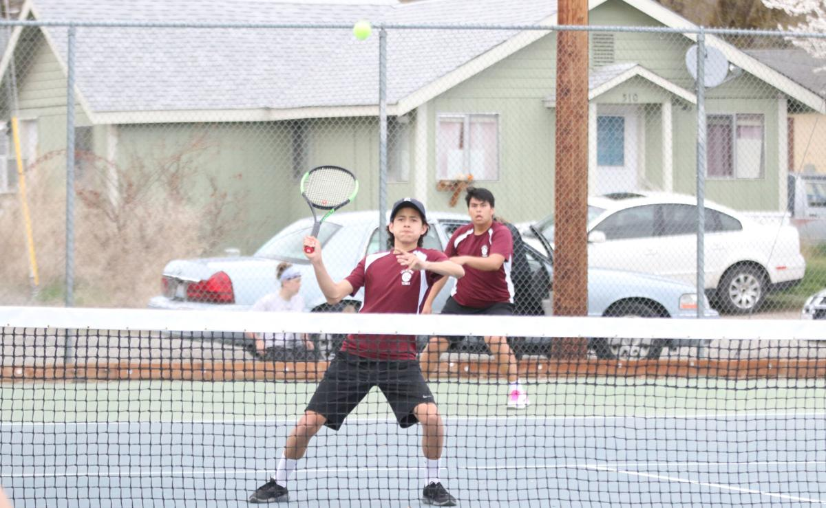 Colville tribal member Morgan George (Red) of Lake Roosevelt gets ready to slam down a shot against the Pioneers in non-league action on Friday (April 12) evening in doubles action at Omak High School