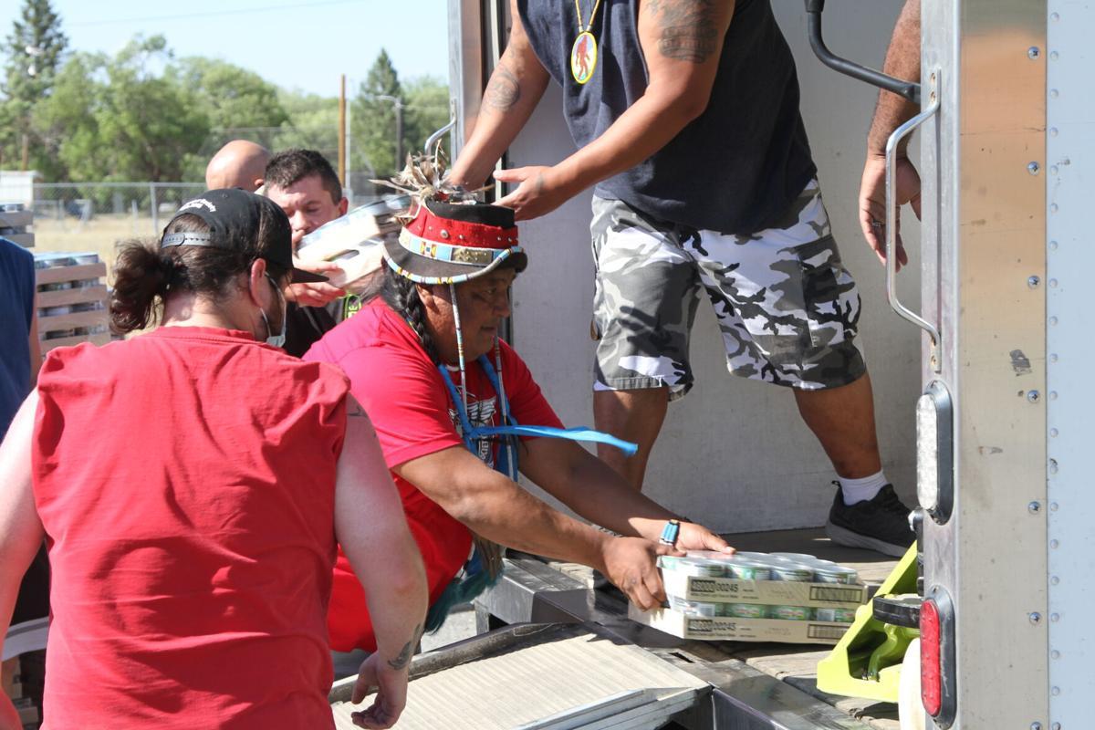 Colville tribal member Dan Nanamkin helps unload cases of food on July 21st